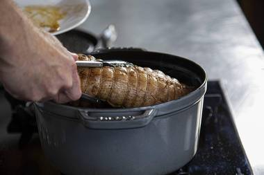 Put the veal roulade back in the pan.